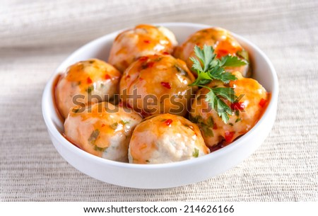 Chicken meatballs with parmesan under spicy sauce - stock photo