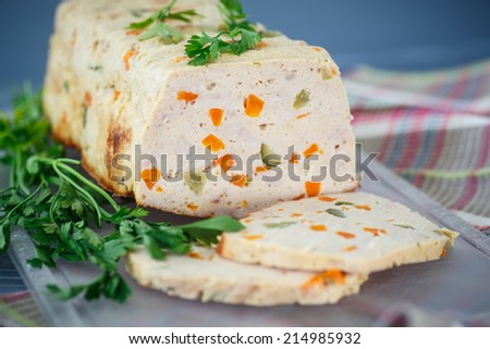 chicken meatloaf with vegetables on the table - stock photo