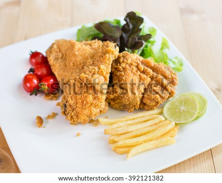 Chicken Milanese with french fries  and vegetable, In white dish