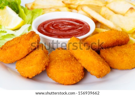 Chicken nuggets with french fries and ketchup - stock photo