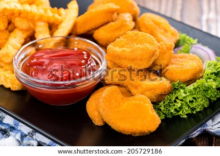 Chicken Nuggets with French Fries (detailed close-up shot) - stock photo