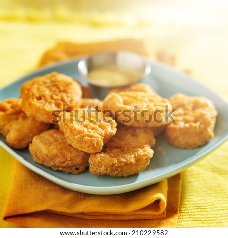 chicken nuggets with honey mustard sauce - stock photo