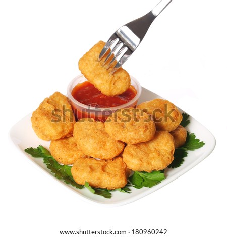 Chicken nuggets with ketchup isolated on white - stock photo