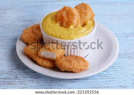 Chicken nuggets with sauce on table close-up - stock photo