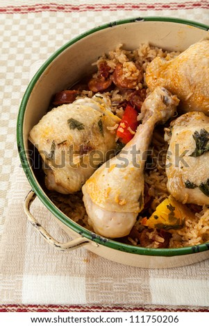 Chicken one pot meal with chorizo and rice - stock photo