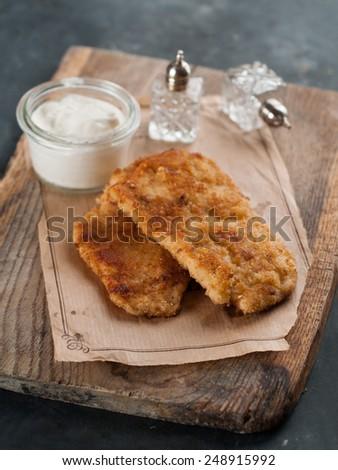 Chicken or pork schnitzel with sauce, selective focus  - stock photo