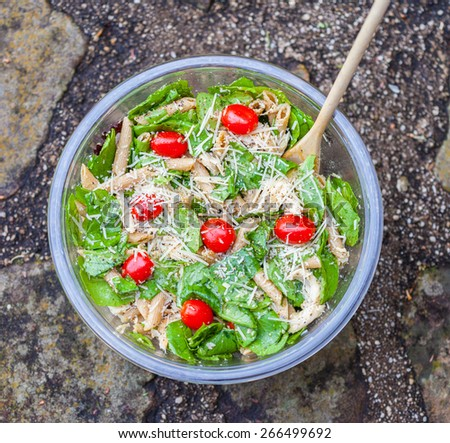 Chicken pasta caesar salad - stock photo