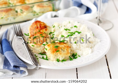 Chicken Patties Baked with Sour Cream Sauce, Served with Rice - stock photo