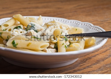 Chicken Penne pesto with spinach, asparagus, and Parmesan cheese - stock photo