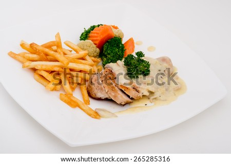 chicken piccata with capern and salad,Grilled chicken breasts and vegetables,chicken breast with fresh cherry tomatoes - stock photo