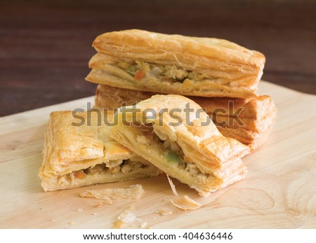 Chicken pie  on wooden block and table / Selective focus  - stock photo