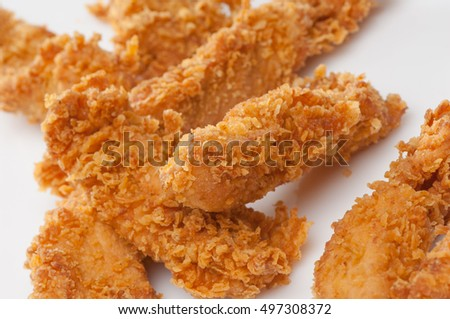 chicken pieces in bread crumbs close up on a white background