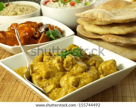 Chicken pieces in indian curry spices, closeup - stock photo