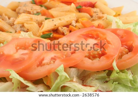 chicken primevera with penne, mixed peppers, and parmesan sauce with lettuce and tomatoes