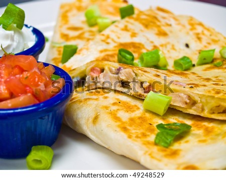 Chicken Quesadilla with Sour Cream and Salsa - stock photo