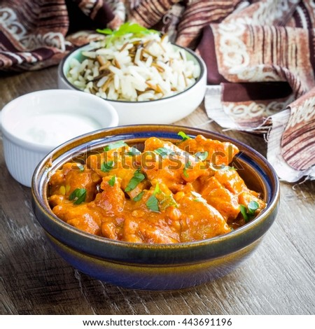 Chicken red curry with rice, delicious Indian dish with meat and sauce