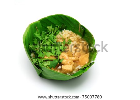 Chicken Rice have coriander on Banana leaf - stock photo