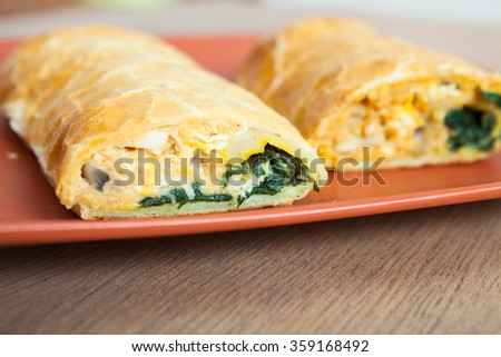 Chicken roll stuffed with spinach and cheese - stock photo