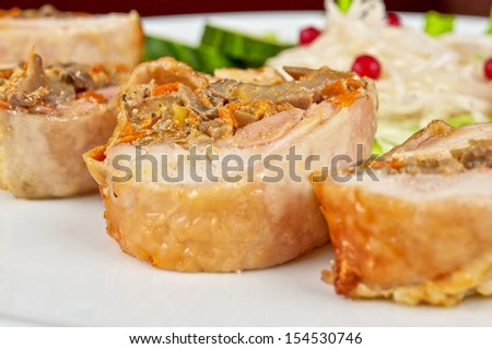 Chicken rolls with champignons and vegetables