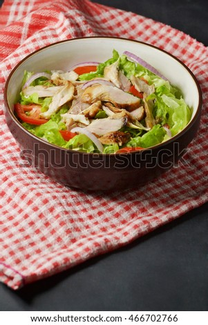 chicken salad bowl on red nakpin
