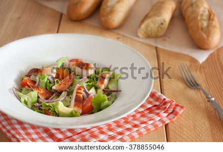 chicken salad with tomatoes and avocado - stock photo