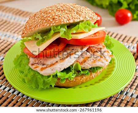 Chicken sandwich with salad and tomato - stock photo