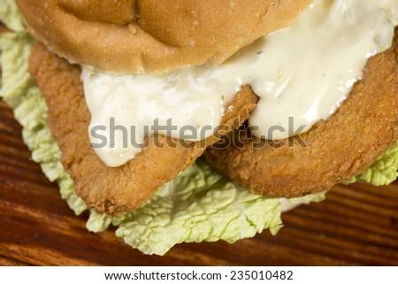 Chicken Sandwich with white meat chicken, generously breaded with homemade with fresh lettuce and creamy mayonnaise