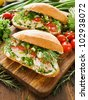 Chicken sandwiches with cherry tomatoes, herbs and cottage cheese. Shallow dof. - stock photo