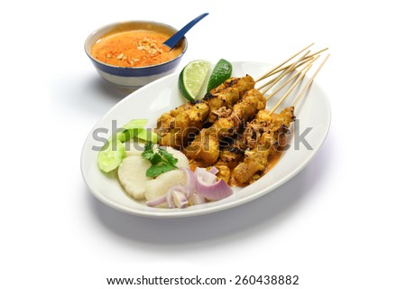 chicken satay with peanut sauce, indonesian skewer cuisine  isolated on white background - stock photo