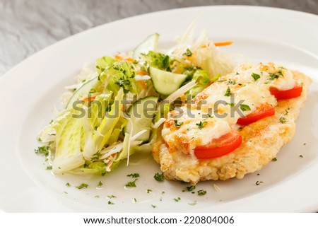 chicken schnitzel with salad - stock photo