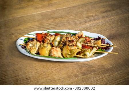 Chicken shish kebab with zucchini and tomatoes - stock photo