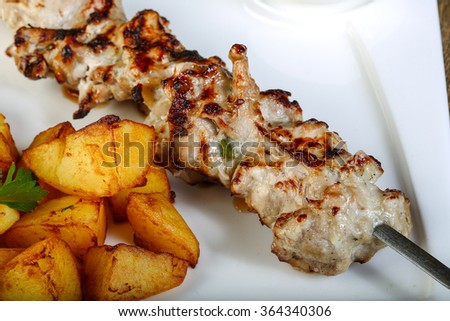 Chicken skewer with potato, herbs and spices - stock photo