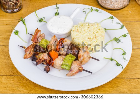 Chicken skewers with vegetables and rice - stock photo