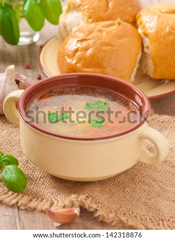 Chicken soup in the brown ceramic bowl - stock photo