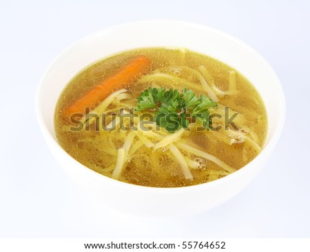 Chicken soup with macaroni and carrots decorated with parsley in a bowl - stock photo