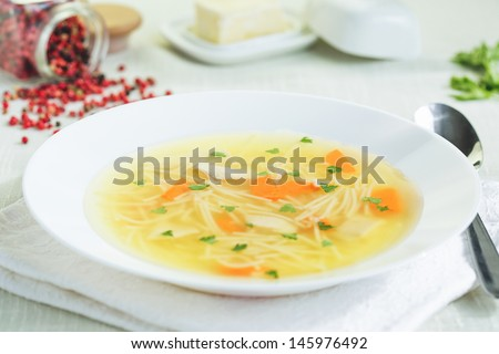 chicken soup with noodles - stock photo