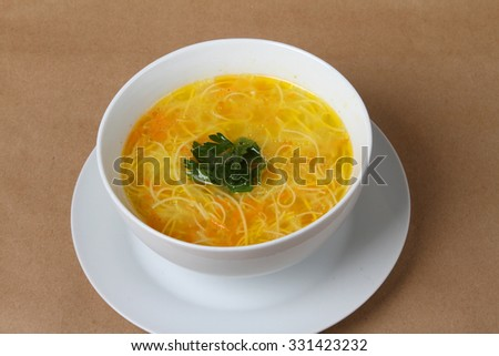 chicken soup with noodles, carrots and parsley - homemade food - my grandmother's cooking - stock photo