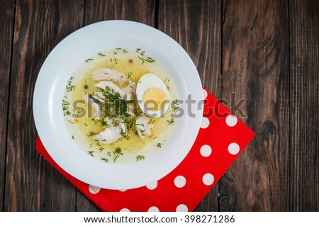 Chicken soup with noodles, carrots, eggs. closeup - stock photo
