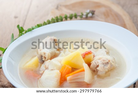 Chicken soup with vegetables in white bowl , homemade - stock photo