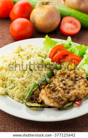 Chicken steak with couscous - stock photo