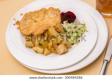 Chicken steak with fried potatoes and coleslaw