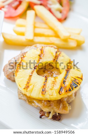 Chicken steak with pineapple on top