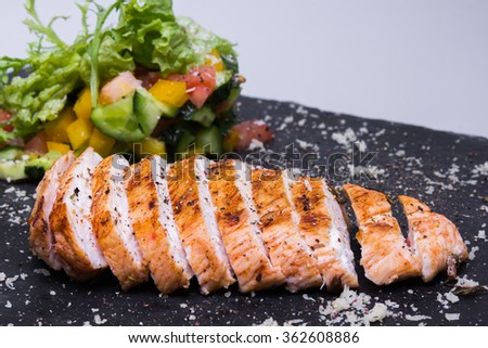 Chicken steak with sauce and vegetables, closeup - stock photo