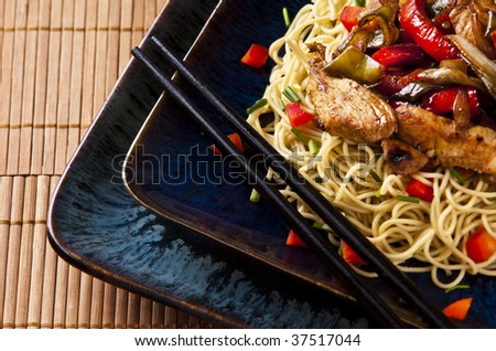 Chicken stir fry with red peppers onion and green beans - stock photo