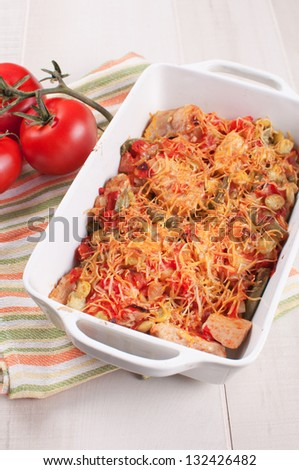 Chicken, string beans and tomatoes cheese casserole top view - stock photo