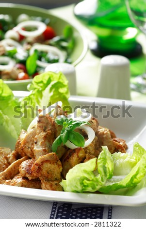 Chicken stripes with salad - stock photo