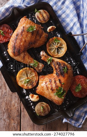Chicken thigh grilled on a grill pan close-up. vertical view from above