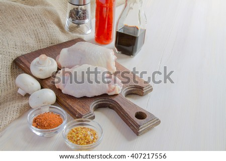 Chicken thighs. Spice. Chili pepper, soy sauce, pepper and mushrooms - stock photo