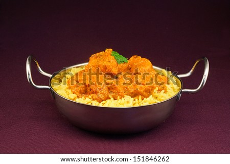 Chicken Tikka masala an indian curry popular developed in Europe as a fusion of Eastern food and modern western tastes - stock photo