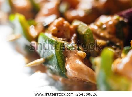 Chicken tikka. Raw chicken shashlik. Isolated on white background. - stock photo